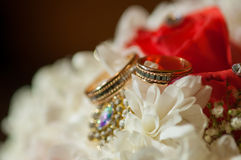 Wedding bouquet of beautiful roses and rings Stock Photo