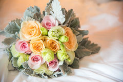 Wedding Bouquet Beautiful on white bed. In room Stock Photos