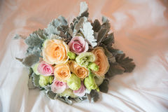 Wedding Bouquet Beautiful on white bed. In room Royalty Free Stock Photo