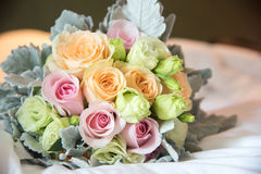 Wedding Bouquet Beautiful on white bed. In room Stock Photo