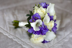 Wedding bouquet on a bed Royalty Free Stock Photos