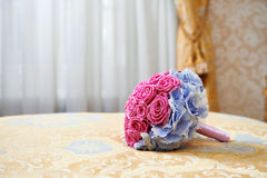 Wedding bouquet on bed in bedroom bride Royalty Free Stock Images