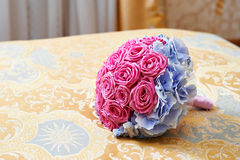 Wedding bouquet on bed in bedroom bride Stock Image