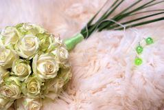 Wedding bouquet and bedspread Royalty Free Stock Photography