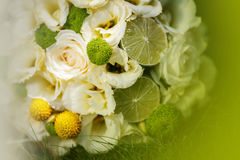 Wedding bouquet from beige roses, cinnamon, a lemon, a lime Stock Photo