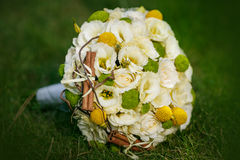 Wedding bouquet from beige roses, cinnamon, a lemon, a lime Stock Photos