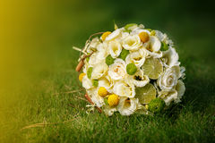 Wedding bouquet from beige roses, cinnamon, a lemon, a lime Royalty Free Stock Photos