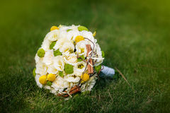 Wedding bouquet from beige roses, cinnamon, a lemon, a lime Stock Image