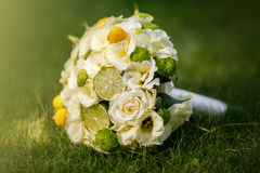 Wedding bouquet from beige roses, cinnamon, a lemon, a lime Stock Images