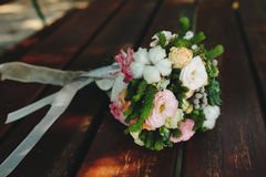 Wedding bouquet on a bench Stock Photography