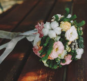 Wedding bouquet on a bench Stock Images