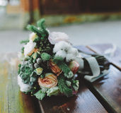 Wedding bouquet on a bench Royalty Free Stock Photos