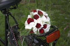 Wedding bouquet on a bike Royalty Free Stock Images