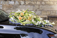 Wedding bouquet on the black car. Stock Image