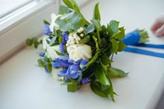 Wedding bouquet with a blue ribbon royalty free stock photography