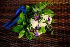 Wedding bouquet with a blue ribbon royalty free stock photo