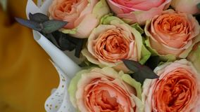 Wedding bouquet of bombastic roses and eucalyptus outdoors, girl dating, close up
