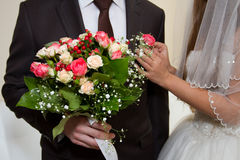 Wedding bouquet and boutonniere. Boutonniere in his jacket pocket Royalty Free Stock Photography