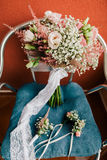 Wedding bouquet and boutonniere Royalty Free Stock Images