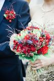 Wedding bouquet on bridal hands. Outdoors on wedding ceremony Stock Photography