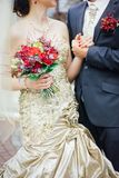 Wedding bouquet on bridal hands. Outdoors on wedding ceremony Stock Photos