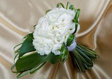 Wedding bouquet of the bride against a fabric Royalty Free Stock Photo