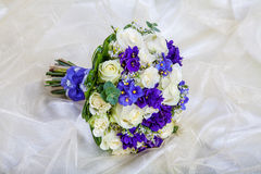 Wedding bouquet of the bride against a  fabric Stock Images