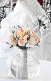 Wedding bouquet with bride in the background Royalty Free Stock Photography