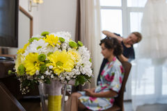 Wedding bouquet and bride in the background. Beautiful wedding bouquet and bride in the background stock photography