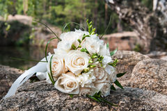 Wedding bouquet of the bride. On a background of nature Stock Photography