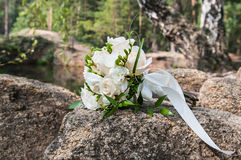 Wedding bouquet of the bride. On a background of nature Stock Images
