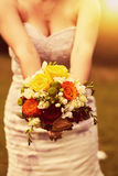Wedding bouquet at the bride Stock Images
