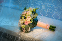 Wedding bouquet of the bride on a blue background Stock Images