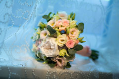 Wedding bouquet of the bride on a blue background Stock Photos