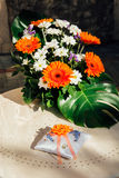 Wedding bouquet for the bride of daisies and wedding rings.  Stock Photography