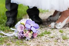 Wedding bouquet and bride and groom Royalty Free Stock Image