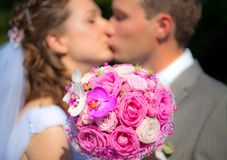 The Wedding Bouquet. With Bride and Groom on the Background royalty free stock photos