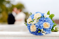 Wedding bouquet with Bride and Groom Stock Image