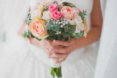 Wedding bouquet of the bride. In hand Royalty Free Stock Photo