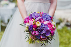 Wedding bouquet of the bride. In hand Royalty Free Stock Photos