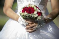 Wedding bouquet in bride hands closeup Stock Images