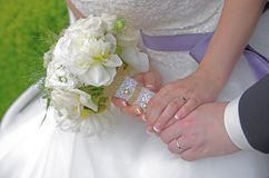 Wedding bouquet. Bride holding wedding bouquet in her hands Royalty Free Stock Photo