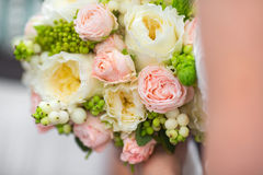 Wedding Bouquet. Bride holding tender pink and white springtime bouquet closeup Stock Photography