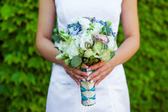 Wedding bouquet. The bride holds wedding bouquet Royalty Free Stock Images