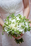 Wedding bouquet. The bride holds wedding bouquet Stock Photography