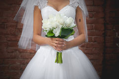 Wedding bouquet. The bride holds wedding bouquet Stock Images