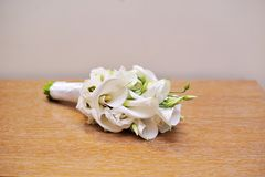 Wedding bouquet of bride lying on table Stock Images