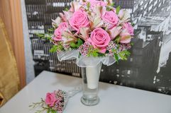 Wedding bouquet for the bride from pink roses in a vase Stock Photos