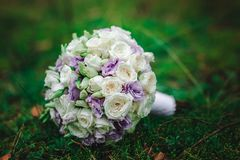 Wedding bouquet bride with purple flowers. Wedding details Stock Photo