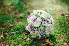 Wedding bouquet bride with purple flowers. Wedding details Stock Photos